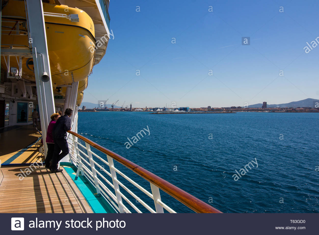 Pisa, Italy - May, 17, 2017: Cruise passengers watch on from the deck as royal caribbean navigator of the seas head to Marina di Pisa. Stock Photo