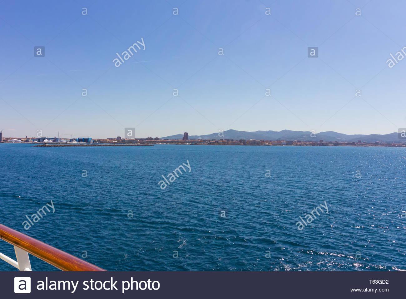 Pisa, Italy - May, 17, 2017: Looking out to seas as a royal caribbean ship pulls into Marina di Pisa. - Stock Image