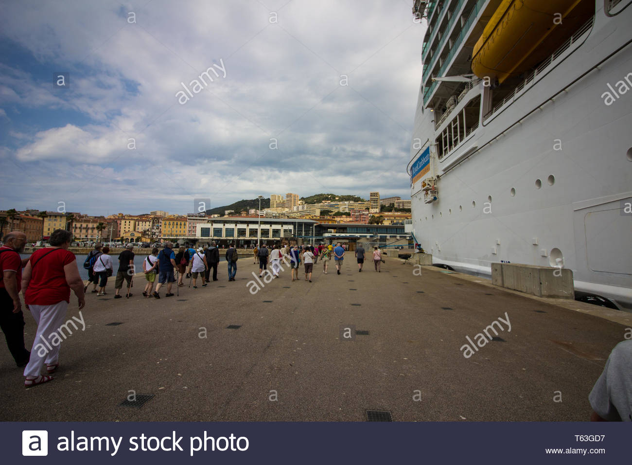 Corsica, France - May, 19, 2017: Cruise passengers making their way from royal caribbean ship to Corsica city. - Stock Image