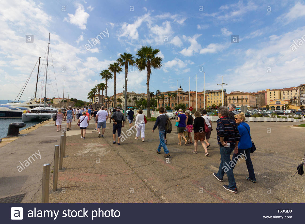 Corsica, France - May, 19, 2017: Tourists walking along the dock at Corsica into the city center - Stock Image