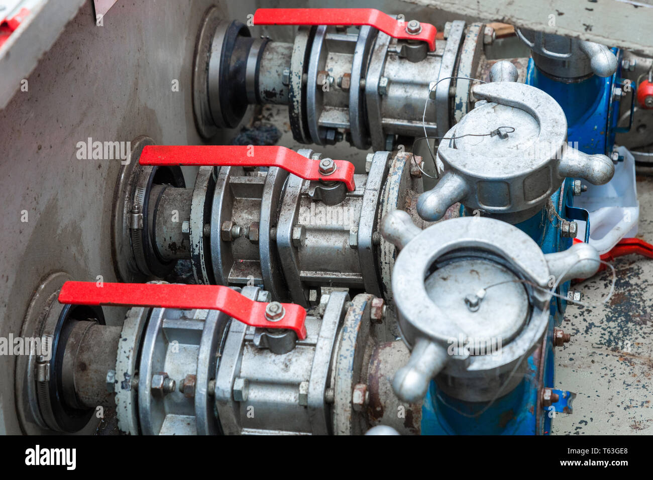 The gate valves at the fuel station - Stock Image