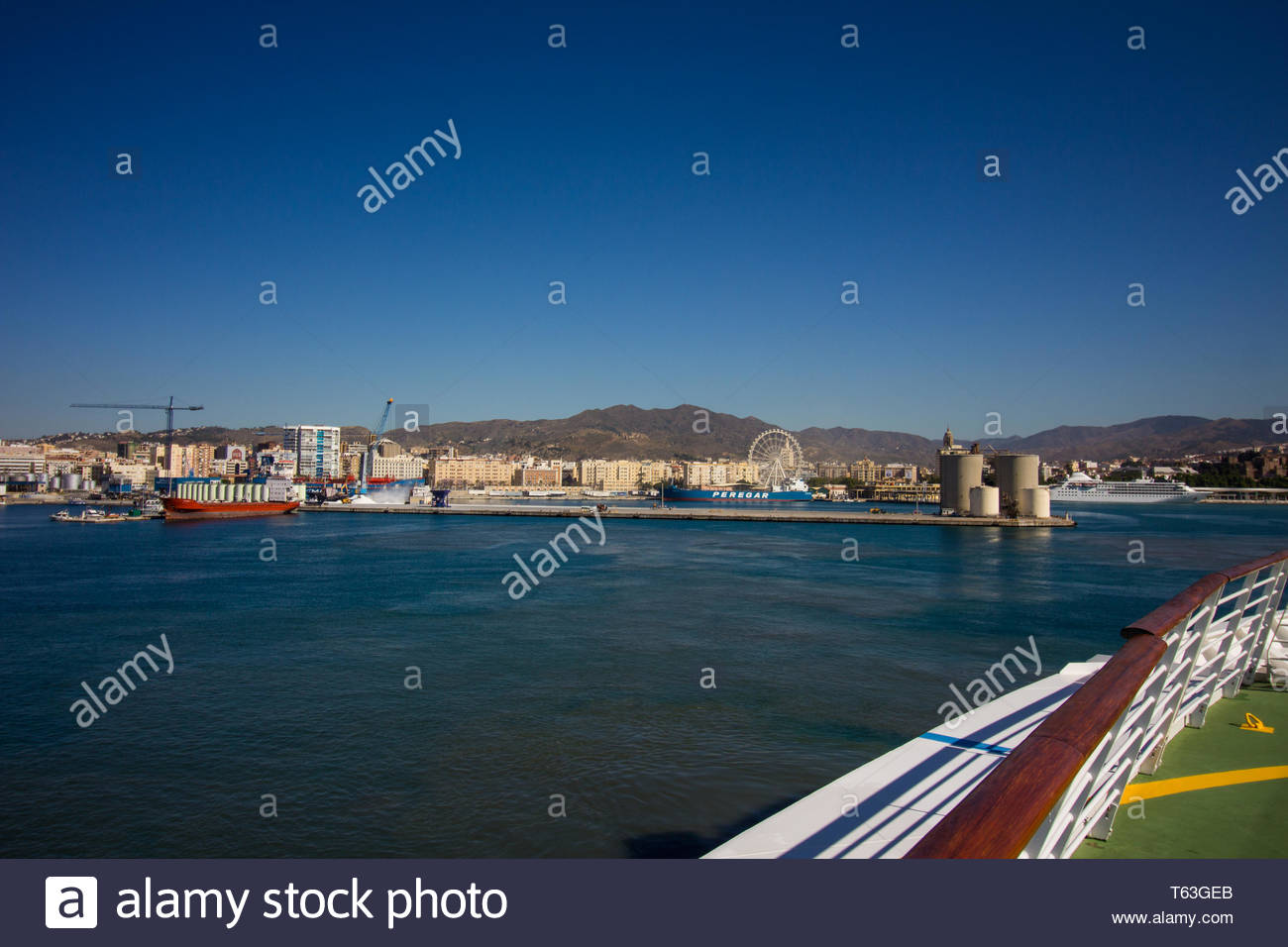 Malaga, Spain - May, 22, 2017: Royal Caribbean cruise ship navigator of the seas making its way to Malaga dock. - Stock Image