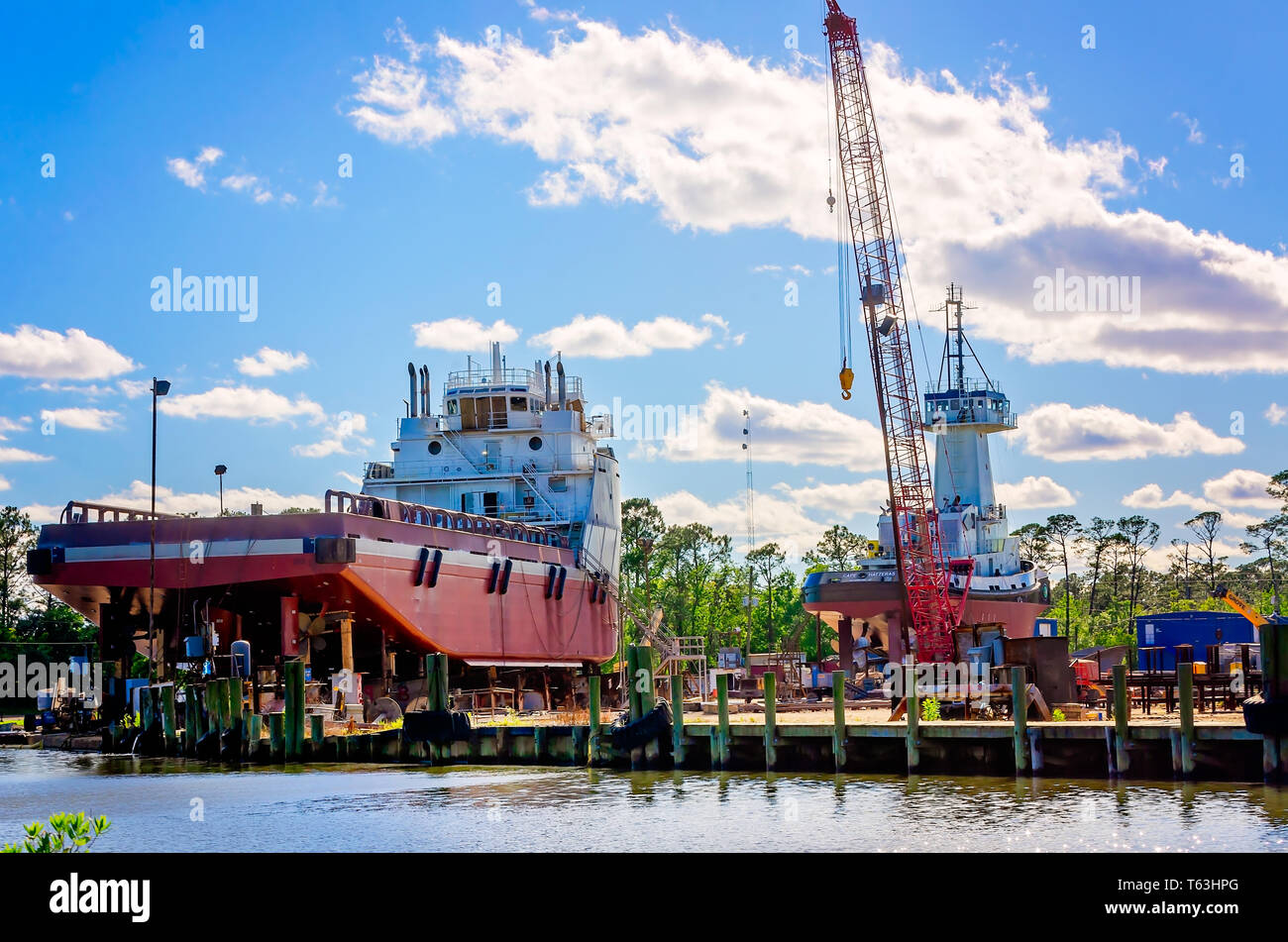 Offshore supply vessels sit at a shipyard in dry dock for repairs, April 14, 2019, in Coden, Alabama. - Stock Image
