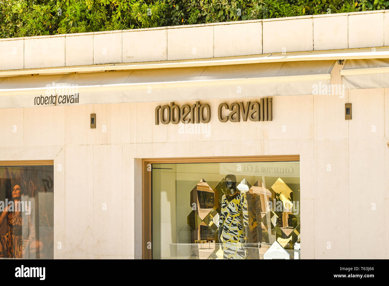 CANNES, FRANCE - APRIL 2019: Exterior of the Roberto Cavalli store on the seafront in Cannes. It is a well known designer brand. Stock Photo