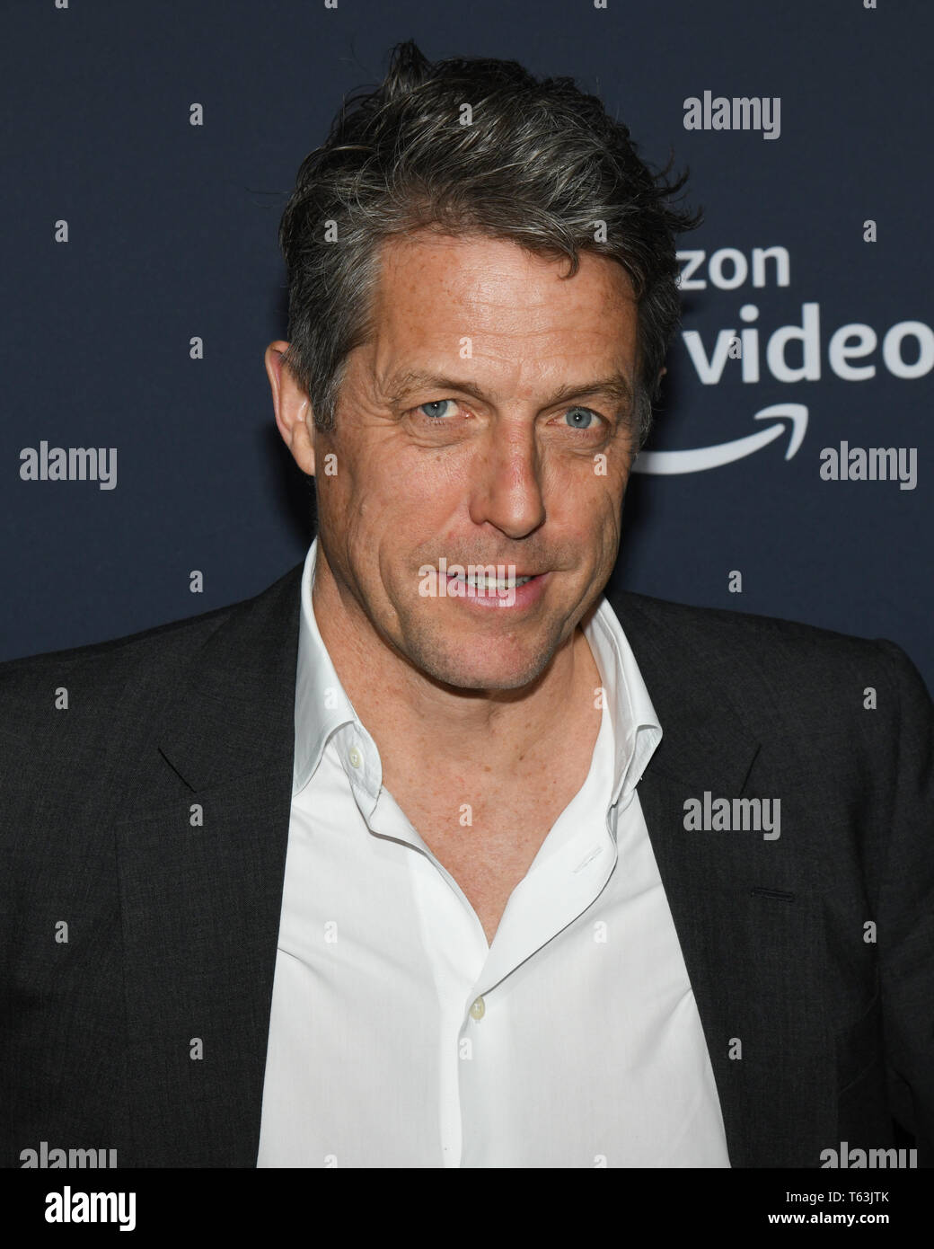April 28, 2019 - Hollywood, California, USA - HUGH GRANT attends the FYC Screening of Amazon Prime Experience 'A Very British Scandal' Screening at the Hollywood Athletic Club in Hollywood, California. (Credit Image: © Billy Bennight/ZUMA Wire) - Stock Image