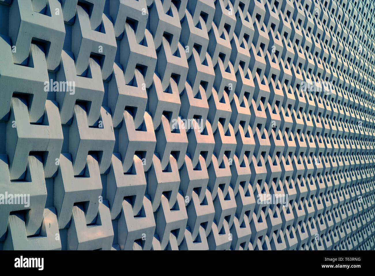 Diminishing perspective of a building 3D decorative pattern metallic grey outer wall - Stock Image