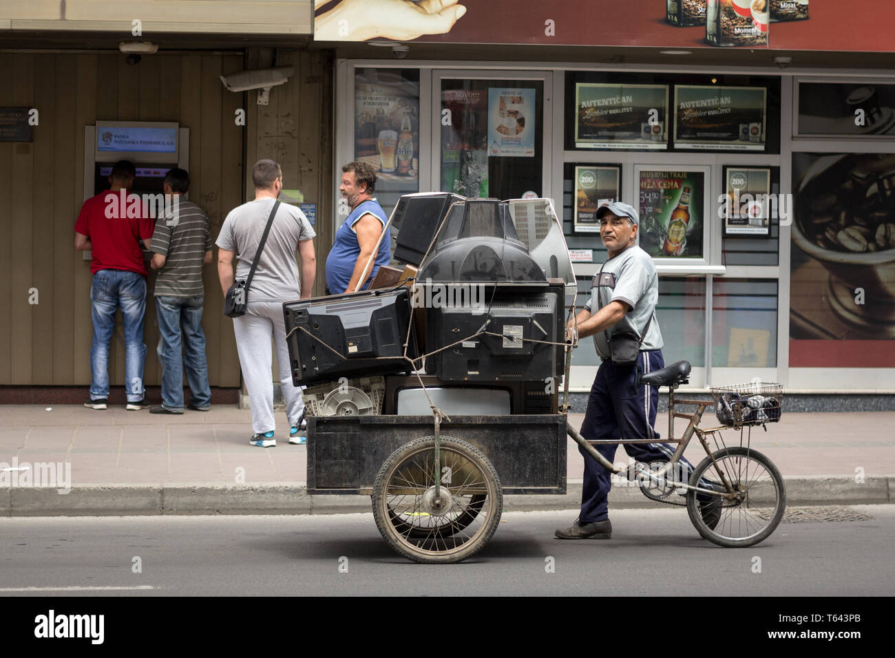 NIS, SERBIA - MAY 9, 2015: Old Man from the Roma community buying old and obsolete CRT Cathod Television Sets, as well as other electronic devoces to  - Stock Image