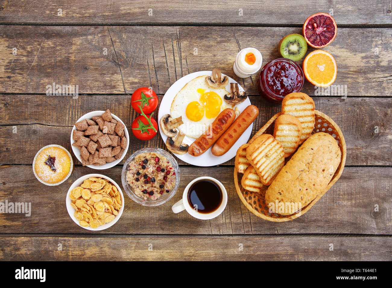 Healthy food on old wooden background. Breakfast. Top view. Flat lay. - Stock Image