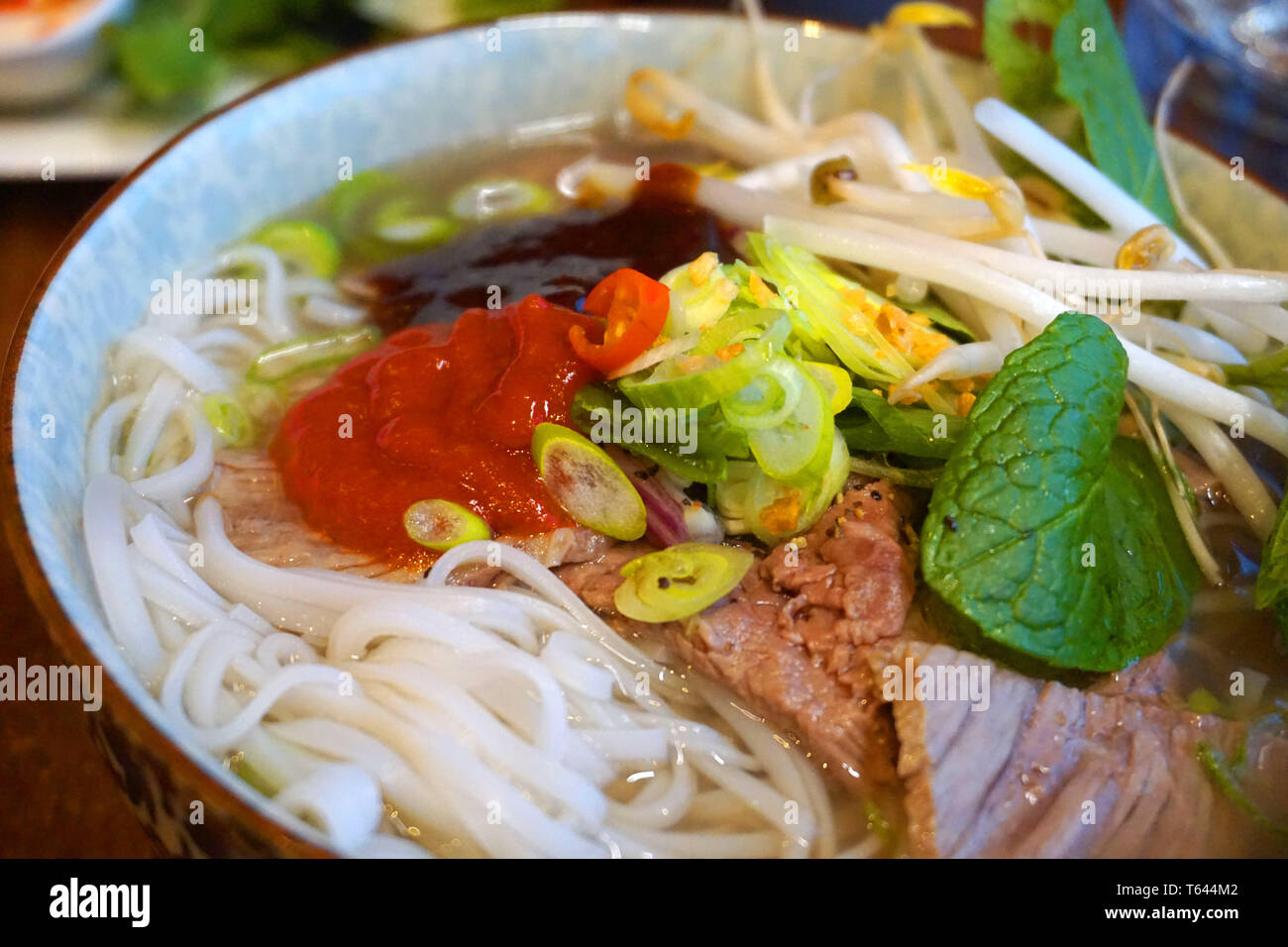 Pho bo - Delicious beef and chicken noodles soup Asian cuisine famous Vietnamese food with beef stock spring onion hoisin sauce soy sauce chilly herb - Stock Image