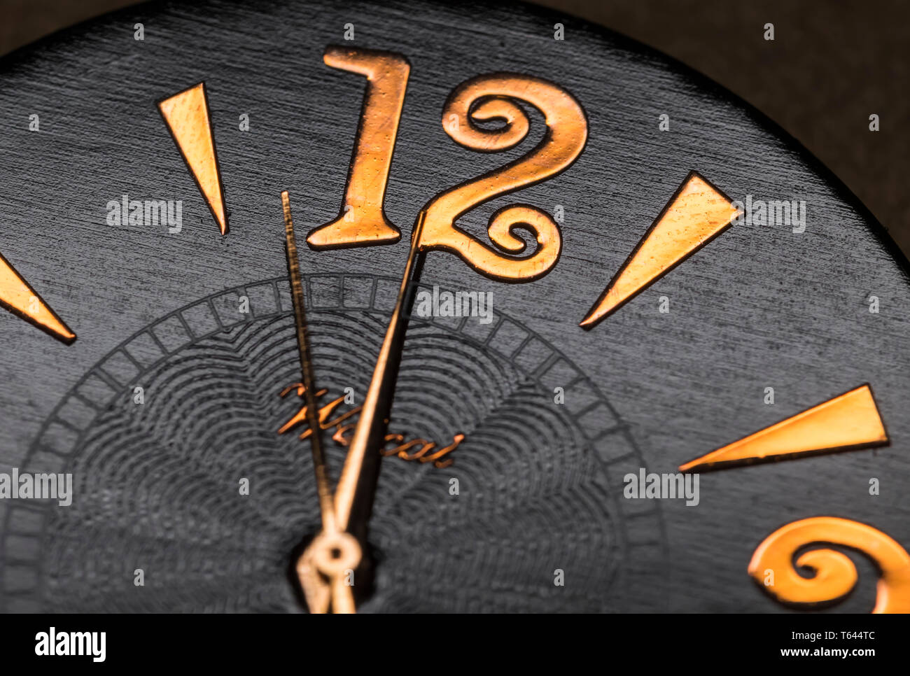 Minute, hour and second hands on a watch face showing nearly 12 o'clock midnight or midday. Macro clock face. Time concept. - Stock Image
