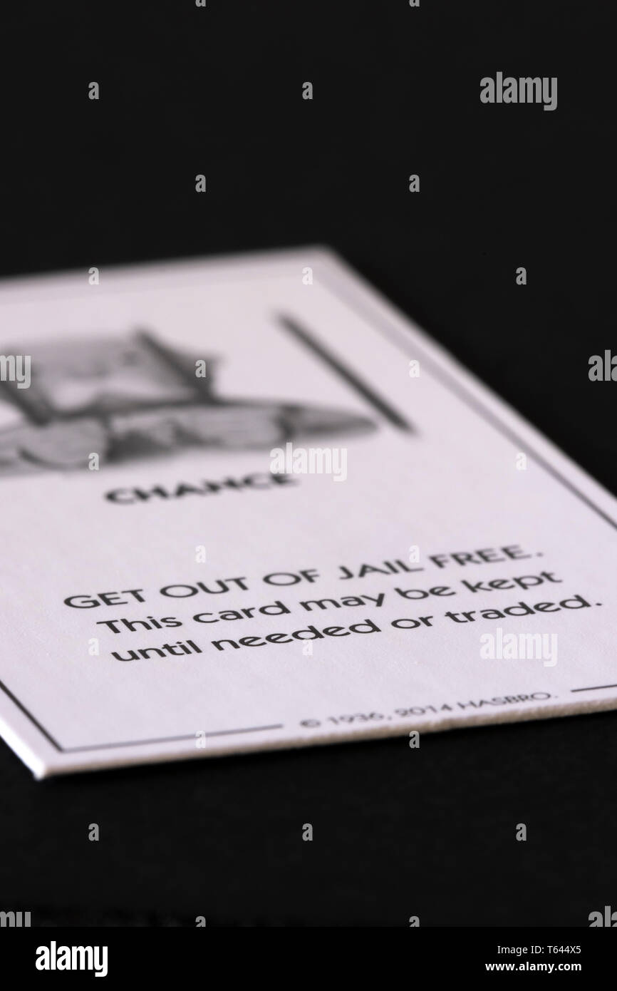 Get out of Jail Free Card from Hasbro's Monopoly, against a black