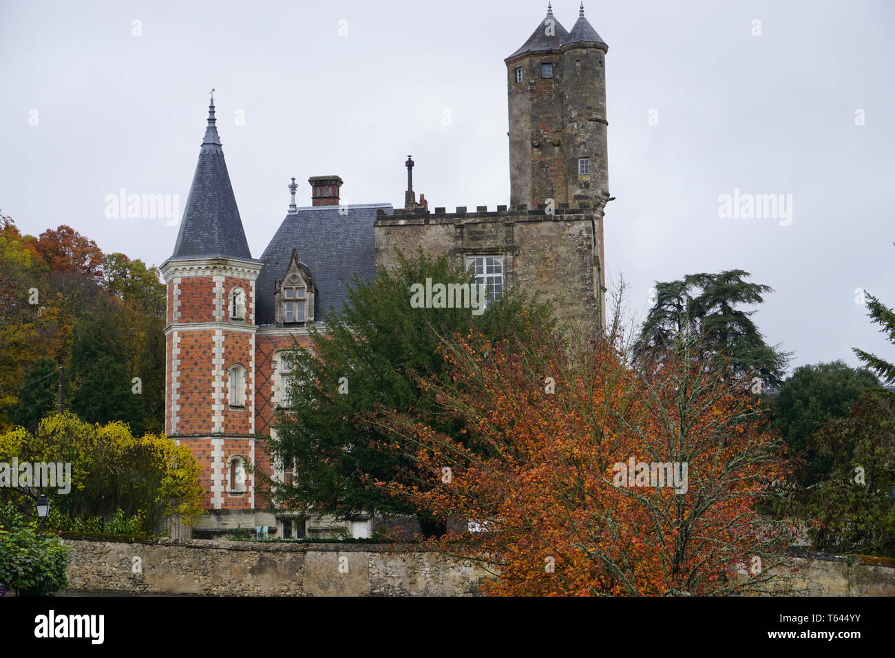 unusual stone tower on an old red brick castle in the country in  France - Stock Image