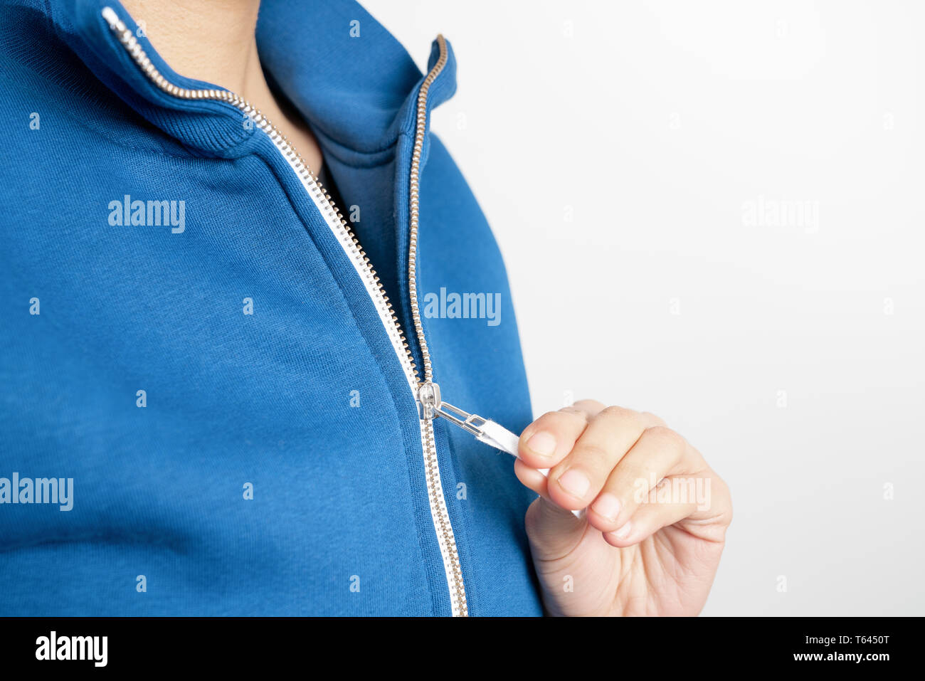 Sweatshirt design and fashion concept - young woman in blue sweatshirt with zipper Stock Photo