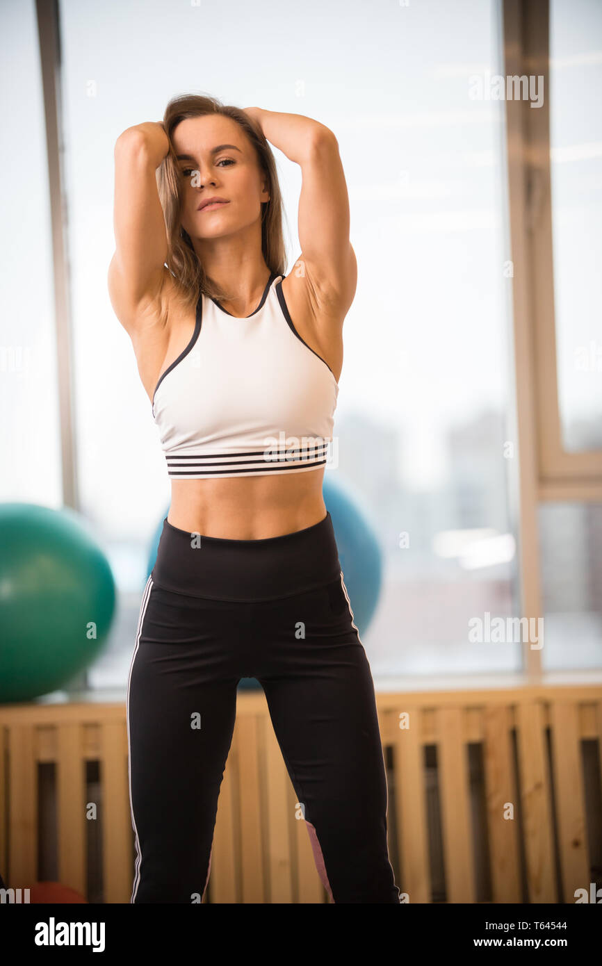 Young athletic woman standing in the fitness studio Stock Photo