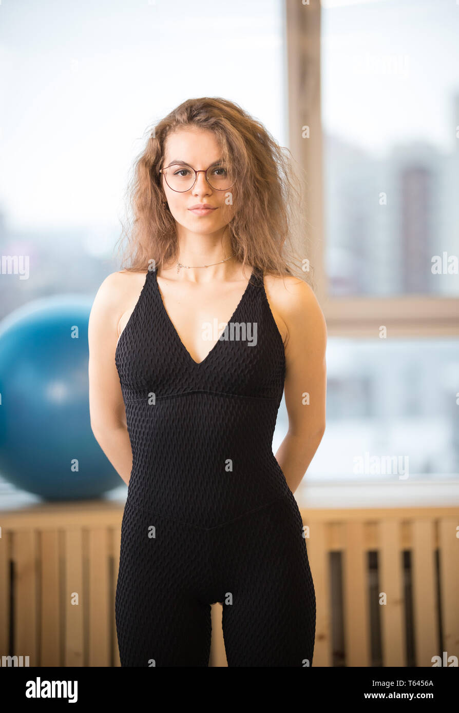 Young pretty woman in glasses in the fitness studio Stock Photo
