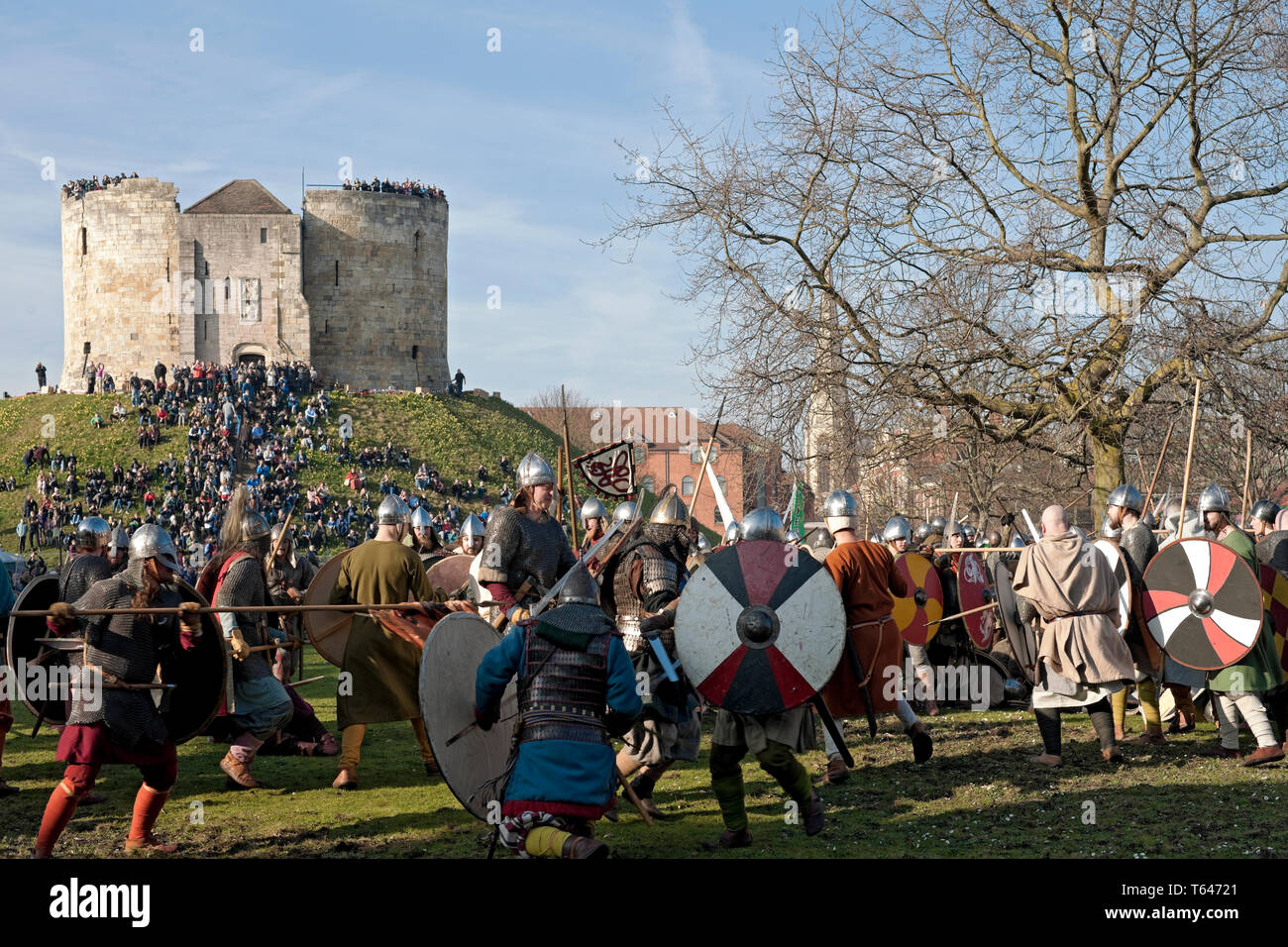 Vikings and Anglo Saxon Warriors in combat at the Viking Festival York North Yorkshire England UK - Stock Image