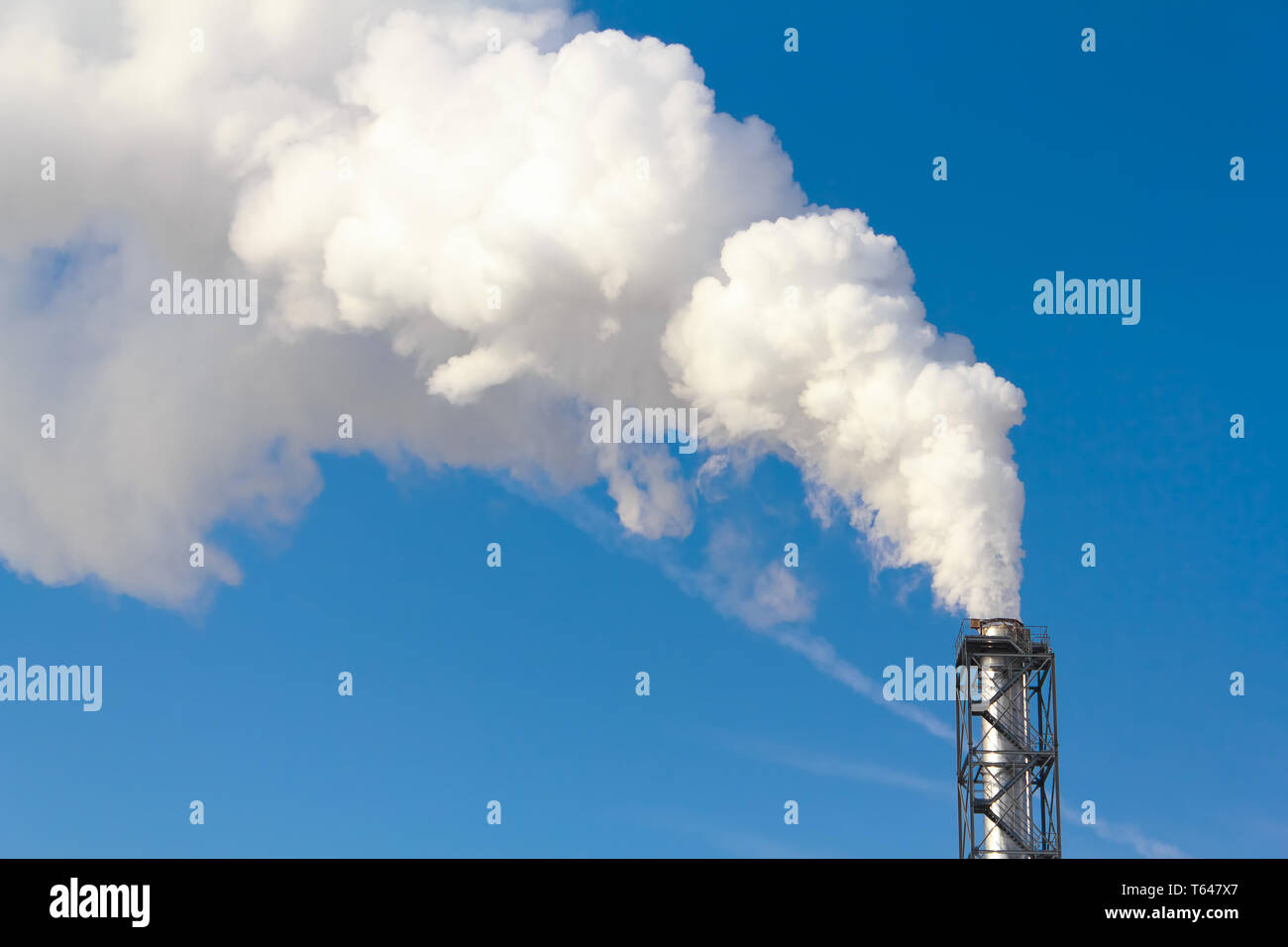 Polluting white smoke coming out of chimney - Stock Image
