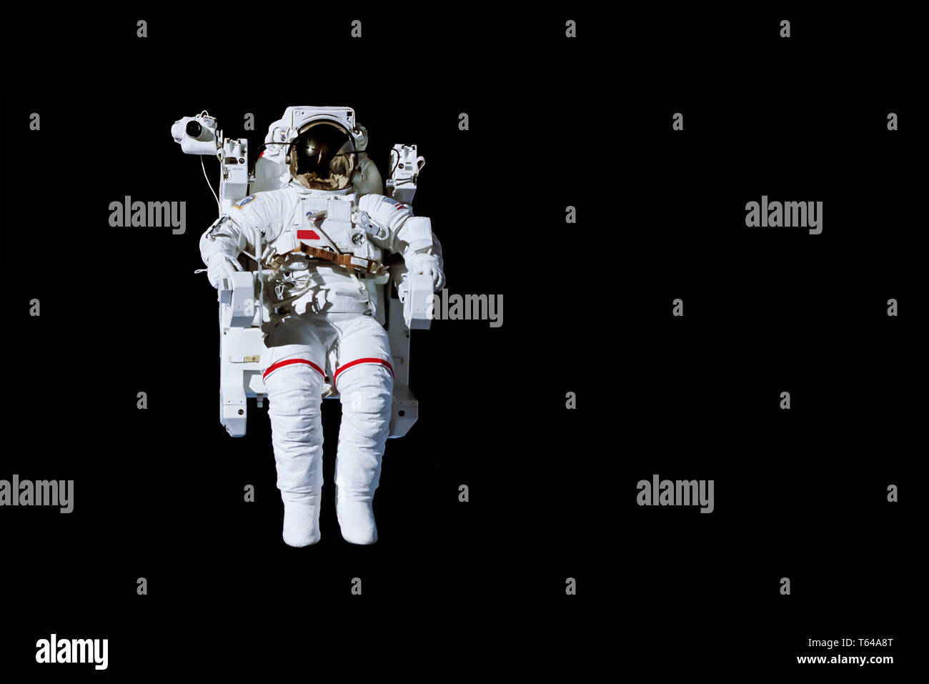 Astronaut with a jetpack isolated on black background with copy space -  Elements of this image are furnished by NASA Stock Photo