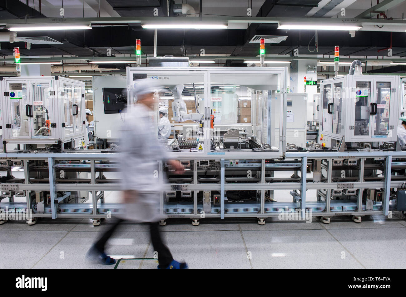 Beijing, China's Guangdong Province. 12th Dec, 2018. A worker passes by a smart production line of Hytera Communications Corporation Limited in Shenzhen, south China's Guangdong Province, Dec. 12, 2018. Credit: Mao Siqian/Xinhua/Alamy Live News - Stock Image