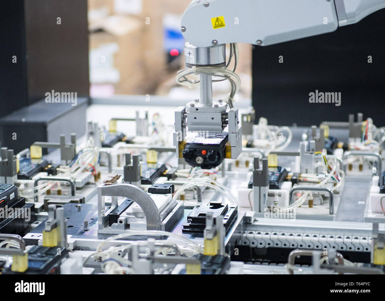 Beijing, China. 12th Dec, 2018. Photo taken on Dec. 12, 2018 shows a smart production line of Hytera Communications Corporation Limited in Shenzhen, south China's Guangdong Province. Credit: Mao Siqian/Xinhua/Alamy Live News - Stock Image
