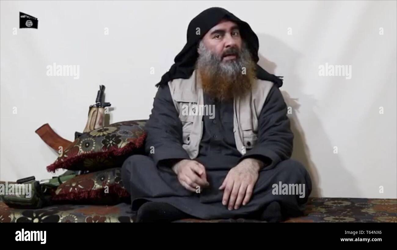 HANDOUT - 29 April 2019, ---: The screenshot of an undated video which was distributed on 29.04.2019 via Al-Furkan, an IS media channel, shows the leader of the IS terrorist militia Abu Bakr al-Bagdadi. Photo: ---/Al-Furkan /dpa - Stock Image