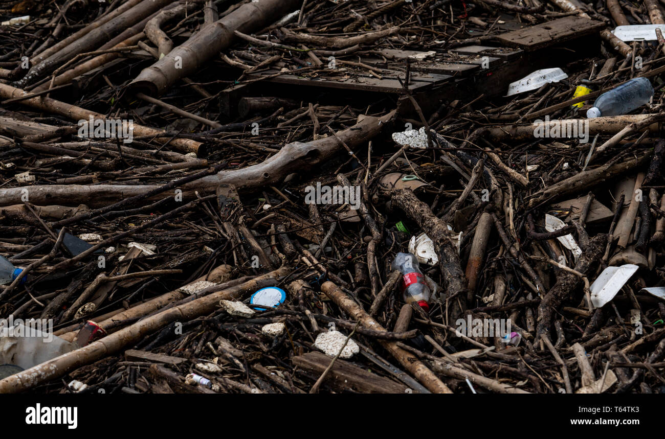 Pile of debris and waste after flood. Waste problem in the environment. Problem of plastic from households. Waste management behavior concept. - Stock Image