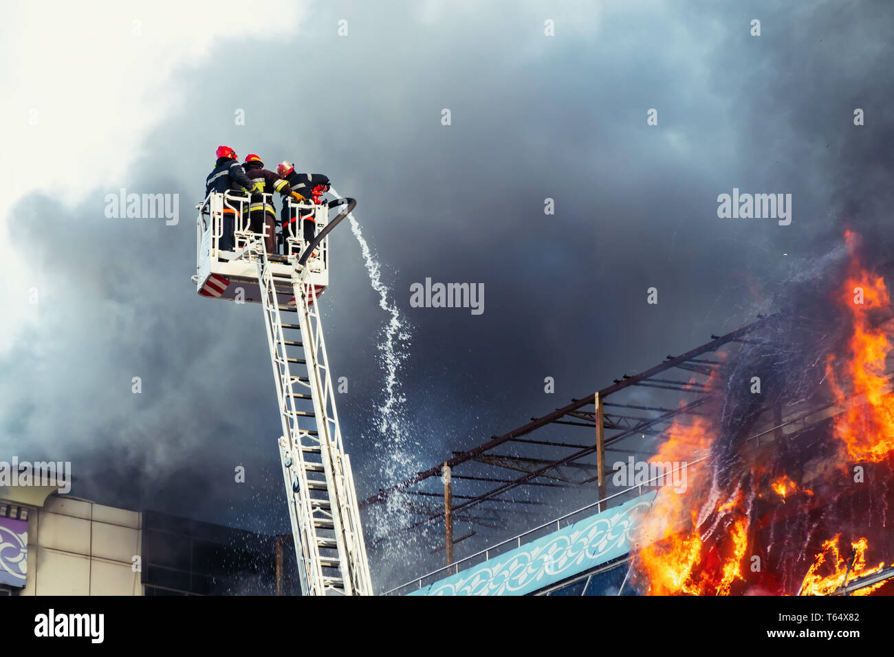 Firefighters extinguish a big fire - Stock Image