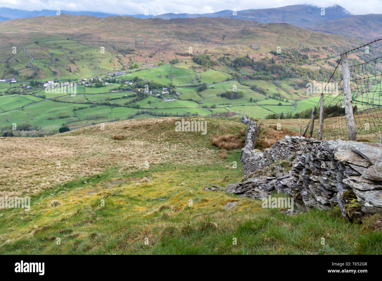 The Village of Troutbeck with Wansfell Pike above Viewed from the Slopes of Sour Howes, Lake District, Cumbria, UK - Stock Image