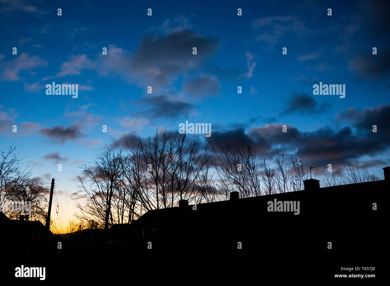 Venus rising above the houses on a winter dawn Stock Photo