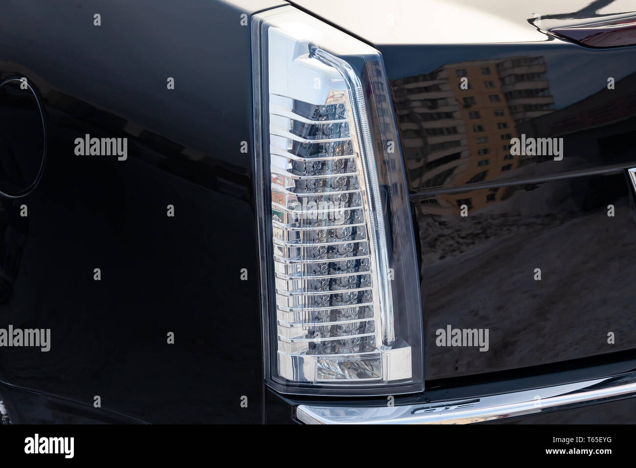Close-up on the rear LED brake light of white color on a black car in the back of a suv after cleaning, polishing and detailing. Auto service industry - Stock Image