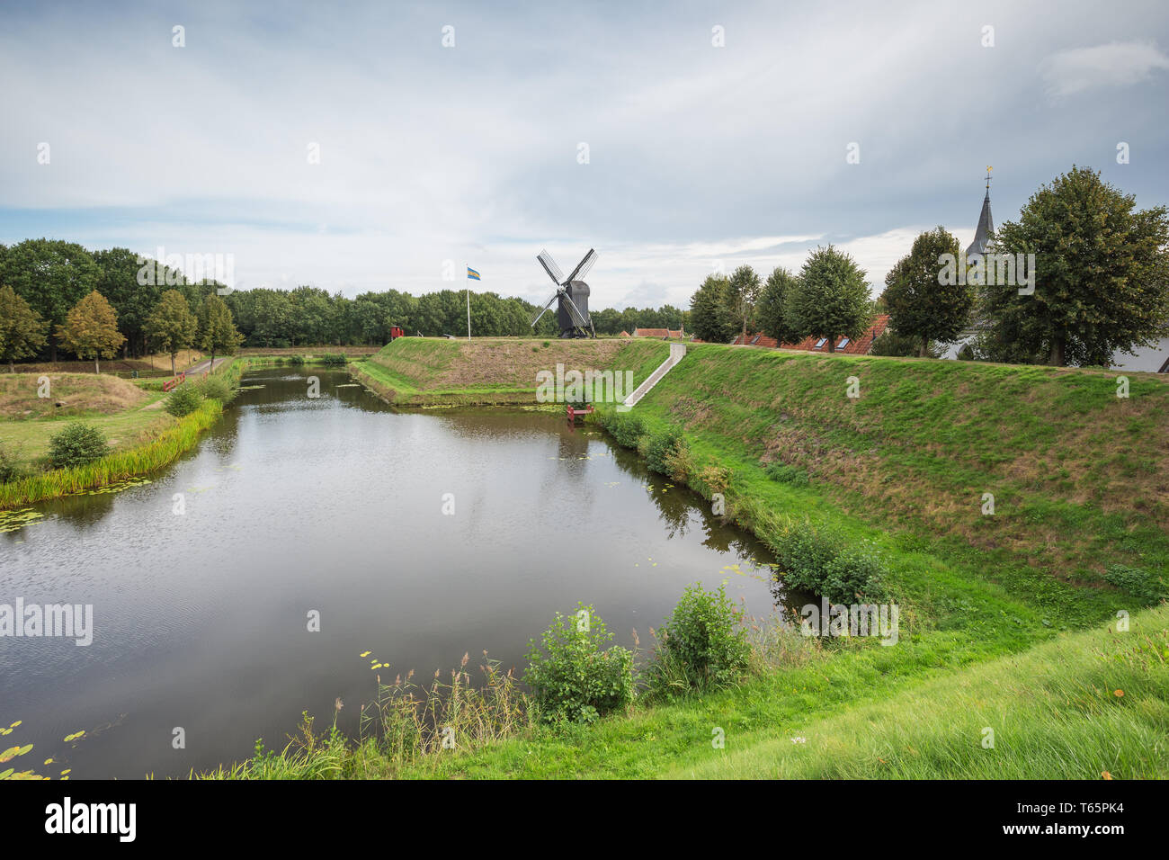 Overlooking the moat around Bourtange with the windmill in the background - Stock Image