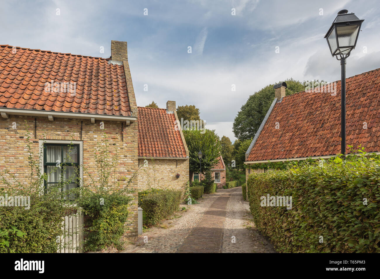 A narrow street with some houses whithin the fortification of Bourtange - Stock Image