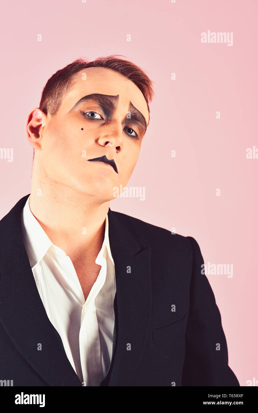 Expressive glance. Mime artist. Man with mime makeup. Mime with face paint. Theatre actor miming. Stage actor playing. Theatrical performance art and - Stock Image