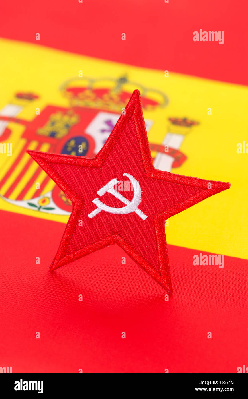 Red Star Hammer and Sickle badge with Spanish flag. Metaphor for Socialist win of 2019 Spanish general election. Stock Photo