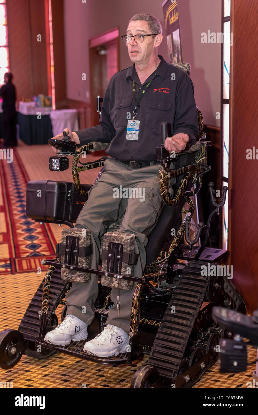 Mt. Pleasant, Michigan - Brian Reno demonstrates the Action Trackstander, an all-terrain motorized wheelchair built by Action Trackchair for disabled  - Stock Image