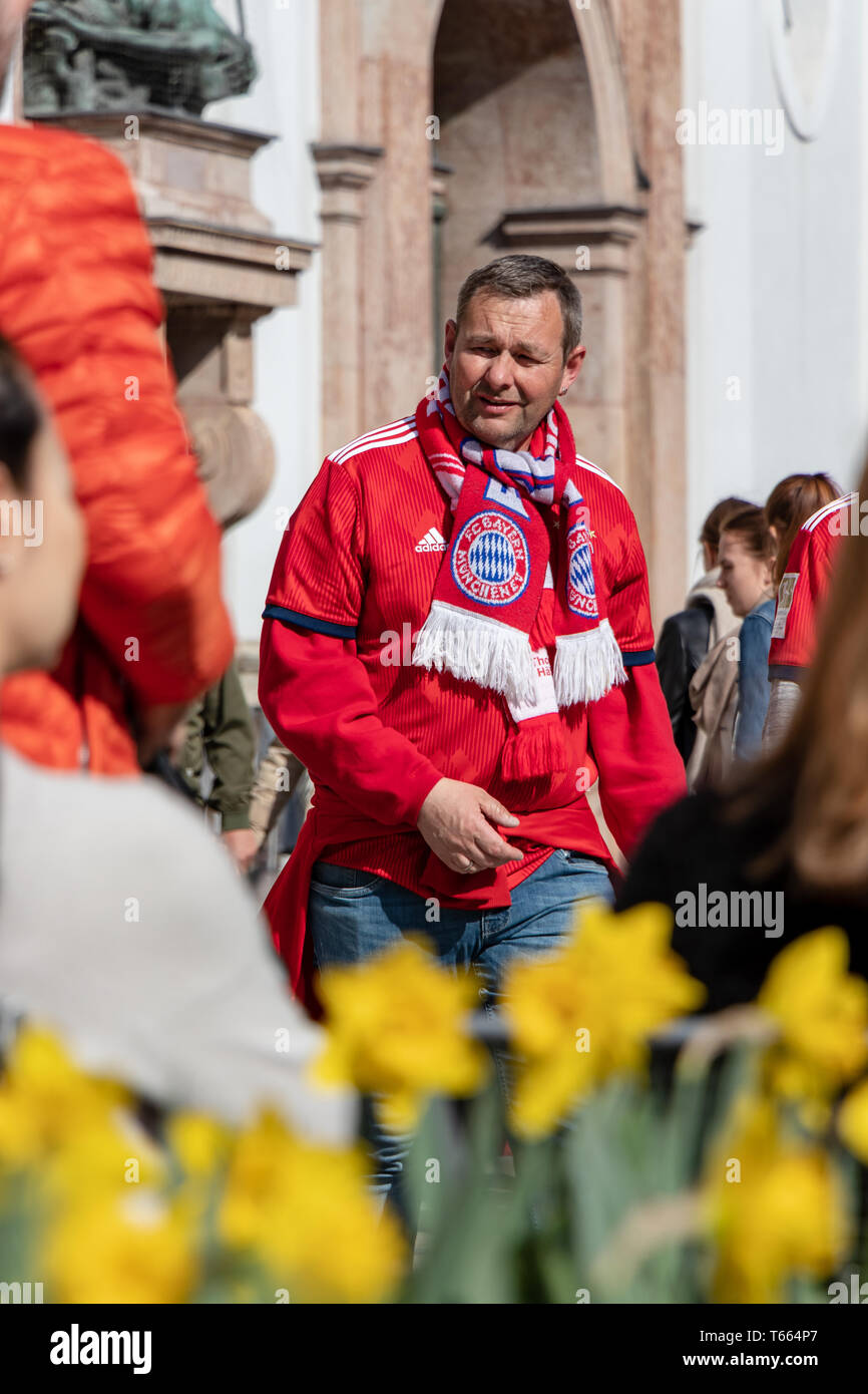 STACHUS, MUENCHEN, APRIL 6, 2019: fc bayern fan on the way to a public viewing location for the soccer game fc bayern munich vs bvb - Stock Image