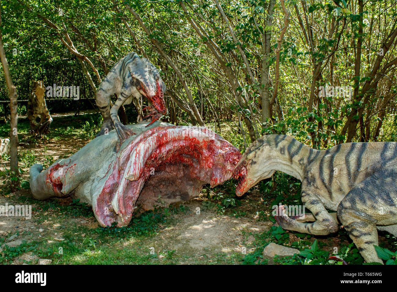 model of two raptors eating pray - Stock Image