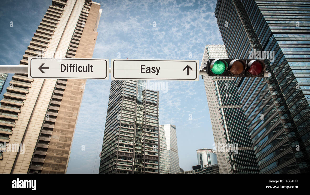 Street Sign the Direction Way to Easy versus Difficult - Stock Image