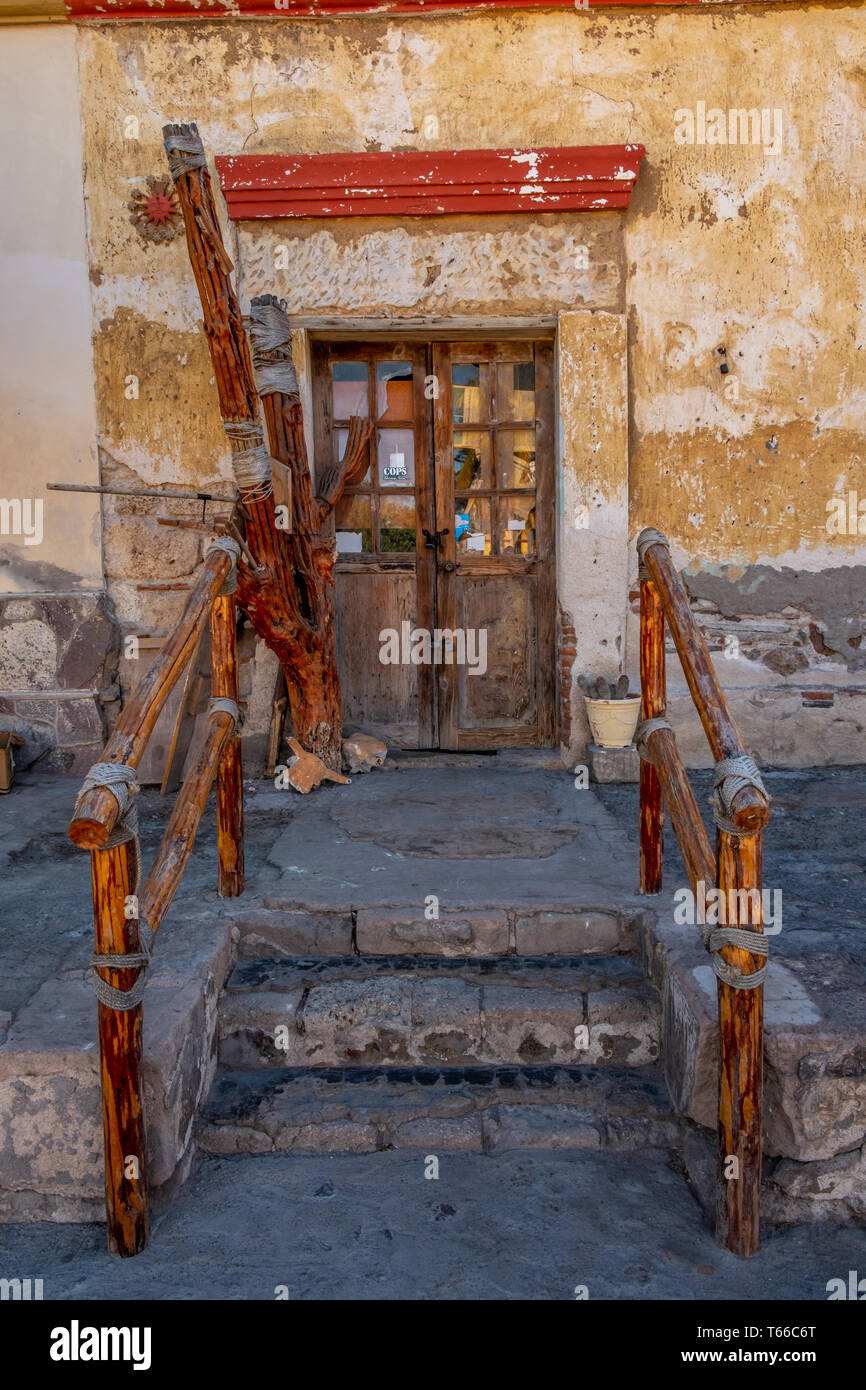 Steps with rustic wood railings leading to a door in Loreto, Baja California Sur, Mexico. Stock Photo