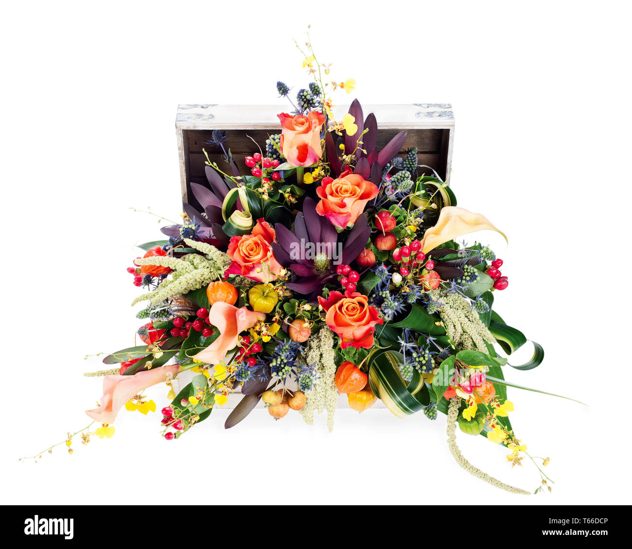 A colorful floral arrangement of roses, lilies, fr - Stock Image
