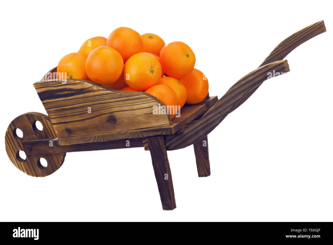 Oranges on pushcart isolated on white background. - Stock Image