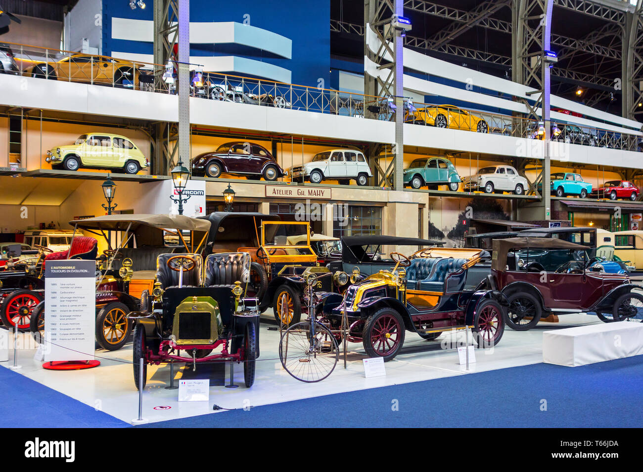 Collection of classic cars, antique vehicles and oldtimers at Autoworld, vintage car museum, Cinquantenaire Park in Brussels, Belgium - Stock Image