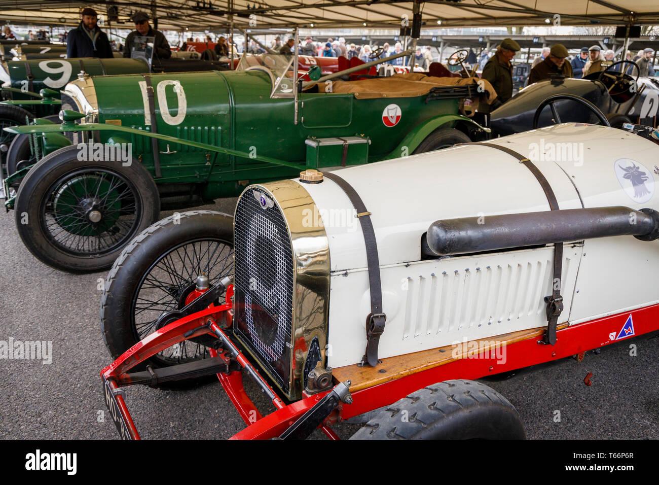 Vintage Bentleys in the paddock garage before the John Duff Trophy race at the 77th Goodwood GRRC Members Meeting, Sussex, UK. - Stock Image