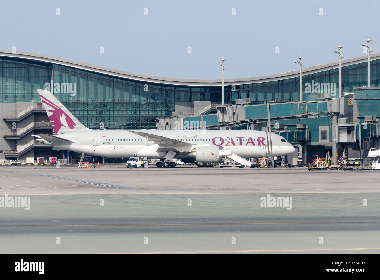 Qatar, Doha,  2018-05-01: Aircraft Qatar Airlines in the parking lot at the Hamad International Airport. Pre-flight check, ground handling. Stock Photo