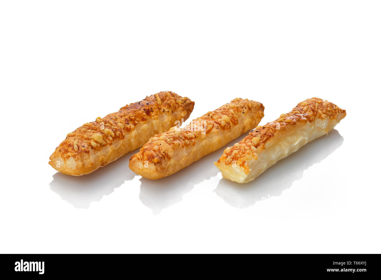 Puff pastry sticks backed with cheese white isolated - Stock Image