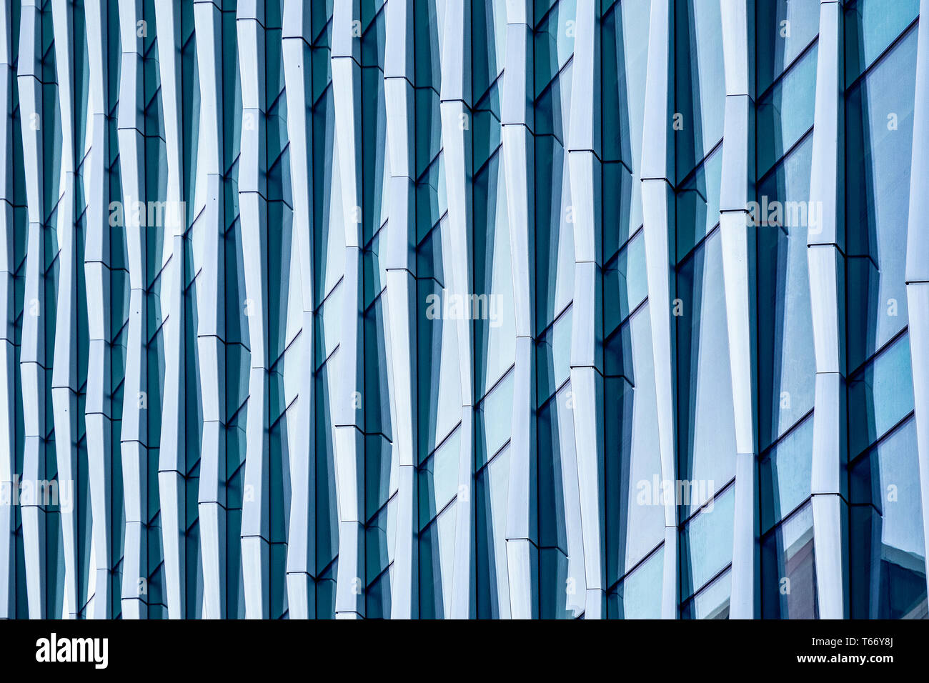 Architectural abstract, a modern office building with glass and windows in London Stock Photo