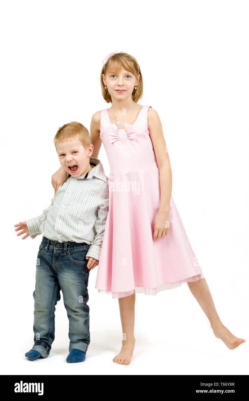 Studio portrait of siblings beautiful boy and girl - Stock Image
