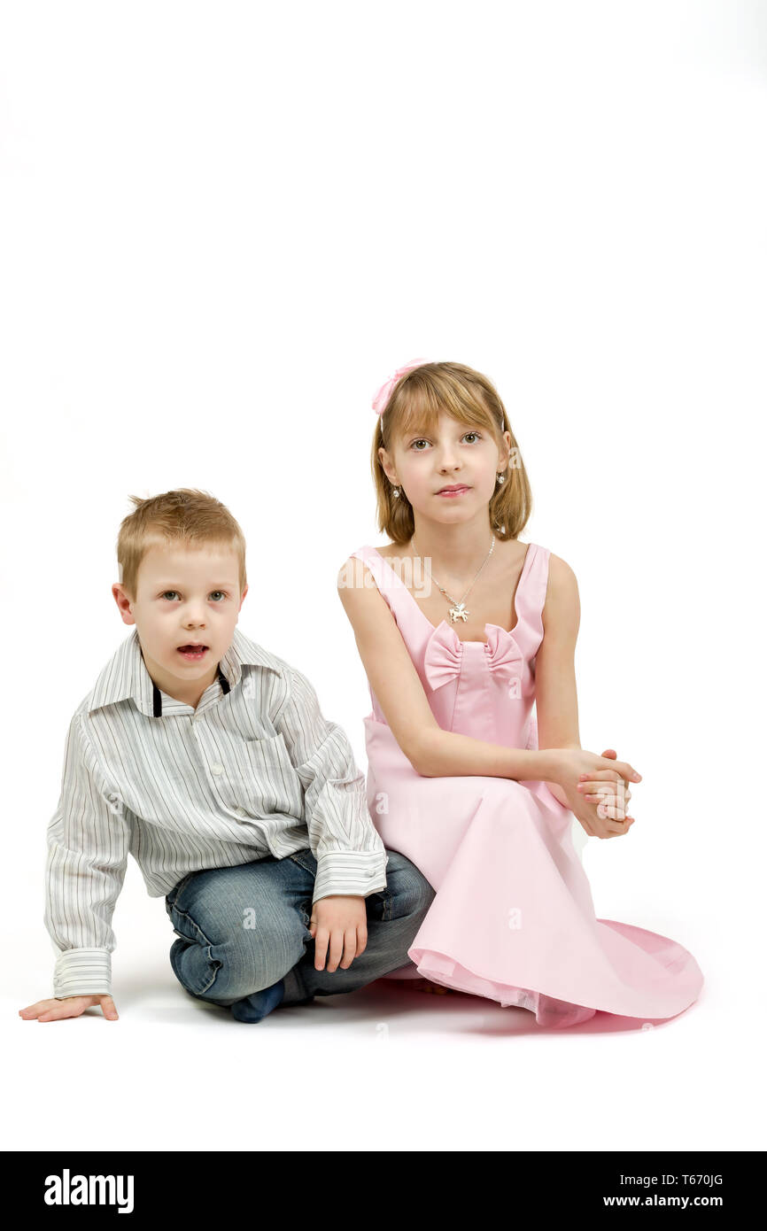 Studio portrait of siblings beautiful boy and girl - Stock Image