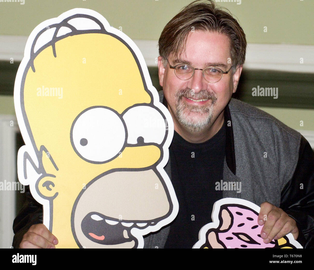 Celebrating ten years of The Simpsons on Sky One, The Simpsons Mania Tour started at The Assembley Rooms in Edinburgh tonight, Monday 14/8/00.  The voices behind the characters performed a rare live read of one of the scripts aided by the series creator Matt Groening. Matt is pictured with his character Homer. - Stock Image