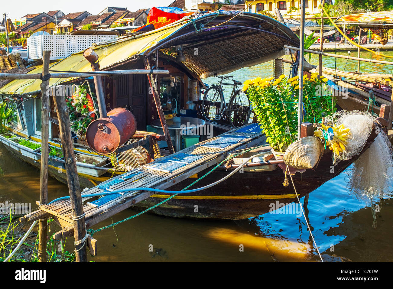 Traditional Vietnamese house boat on Son Thu Bon river at Hoi An, Quang Nam Provence, Vietnam, Asia - Stock Image